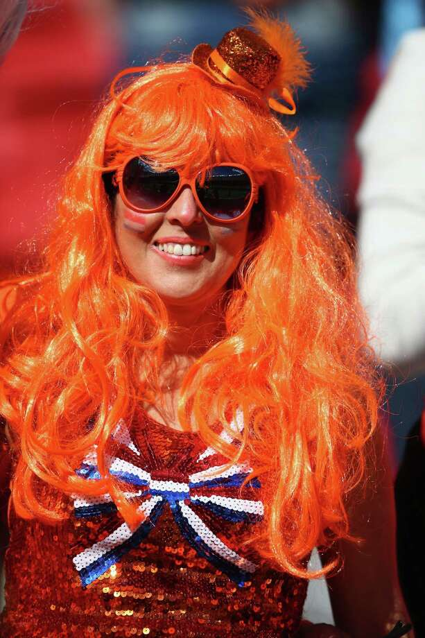 PORTO ALEGRE, BRAZIL - JUNE 18:  A fan of the Netherlands enjoys the atmosphere prior to the 2014 FIFA World Cup Brazil Group B match between Australia and Netherlands at Estadio Beira-Rio on June 18, 2014 in Porto Alegre, Brazil. Photo: Ian Walton, Getty Images / 2014 Getty Images