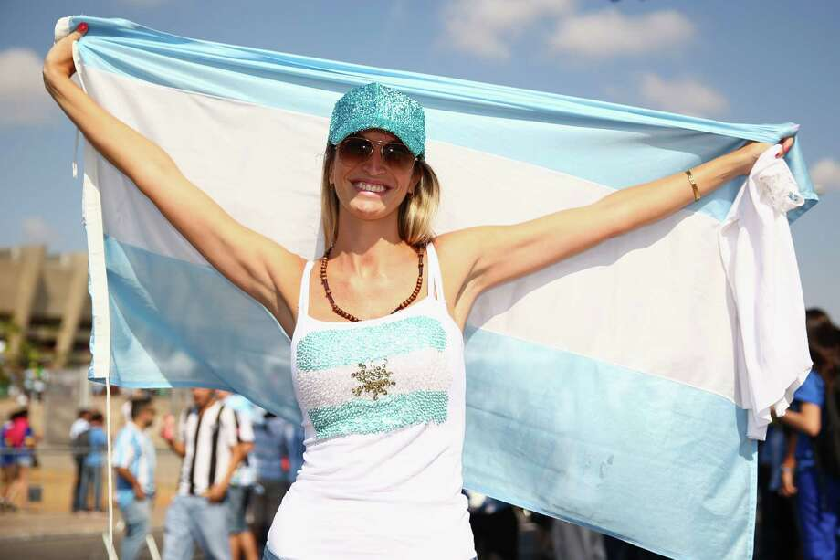BELO HORIZONTE, BRAZIL - JUNE 21: An Argentina fan enjoys the atmosphere prior to the 2014 FIFA World Cup Brazil Group F match between Argentina and Iran at Estadio Mineirao on June 21, 2014 in Belo Horizonte, Brazil. Photo: Ian Walton, Getty Images / 2014 Getty Images