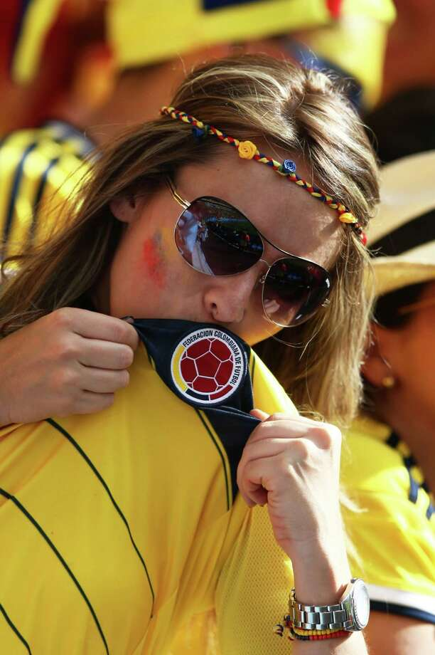 BRASILIA, BRAZIL - JUNE 19: A Colombia fan celebrates during the 2014 FIFA World Cup Brazil Group C match between Colombia and Cote D'Ivoire at Estadio Nacional on June 19, 2014 in Brasilia, Brazil. Photo: Warren Little, Getty Images / 2014 Getty Images