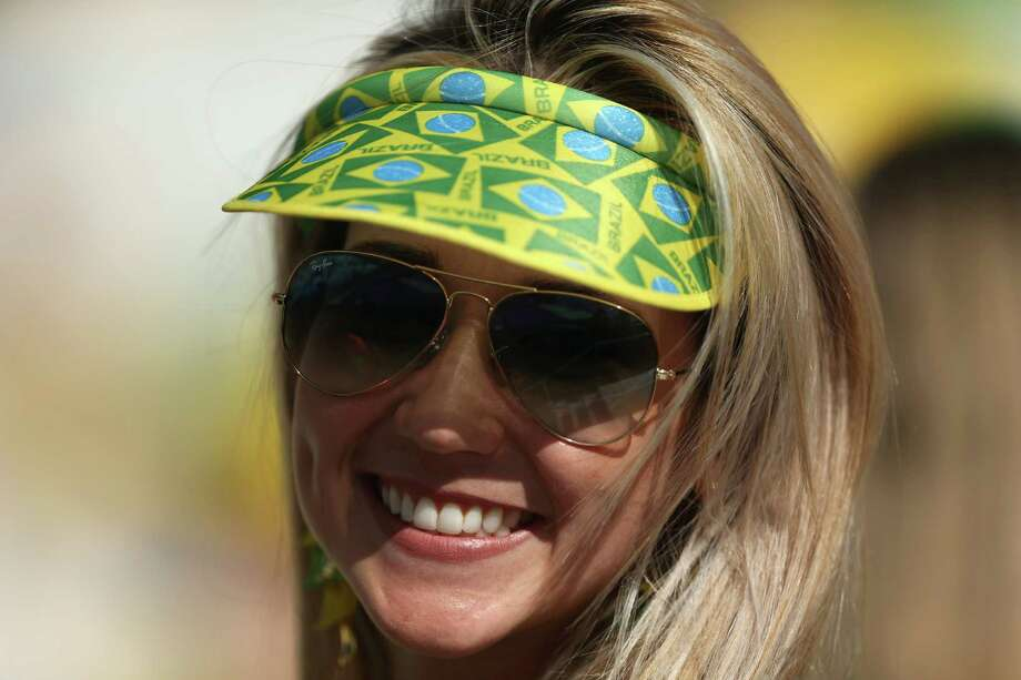 SAO PAULO, BRAZIL - JUNE 12:  A Brazil fan smiles before the Opening Ceremony of the 2014 FIFA World Cup Brazil prior to the Group A match between Brazil and Croatia at Arena de Sao Paulo on June 12, 2014 in Sao Paulo, Brazil. Photo: Warren Little, Getty Images / 2014 Getty Images