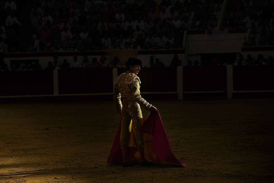 Spanish bullfighter Jose Tomas prepares to perform with an El Pilar ranch fighting bull during a bullfight in Leon, Spain, Sunday, June 22, 2014. Bullfighting is an ancient tradition in Spain and Tomas is Spain's most popular bullfighter, after coming back from an injury he has only fought a few fights this season, keeping fans yearning for more opportunities to see their idol. (AP Photo/Daniel Ochoa de Olza) Photo: Daniel Ochoa De Olza, Associated Press