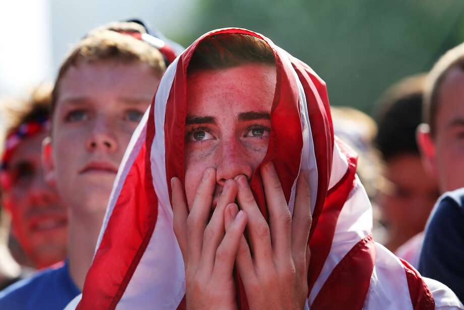 Patrick Roder, 21, watches a televised group G World Cup soccer match between Portugal and USA during a watch party in Grant Park on Sunday, June 22, 2014, in Chicago. (AP Photo/Sun-Times Media, Chandler West) Photo: Chandler West, Associated Press