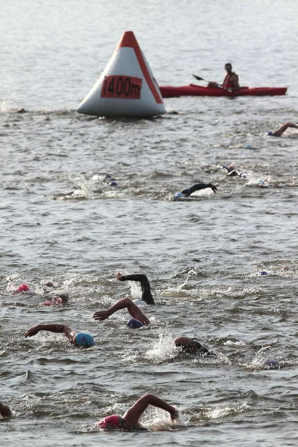 Competitors swim in the Schuykill River during the swim portion of the Philadelphia Triathlon, Sunday, June 22, 2014, in Philadelphia. ( AP Photo/The Philadelphia Inquirer, David Swanson) PHIX OUT; TV OUT; MAGS OUT; NEWARK OUT Photo: David Swanson, Associated Press