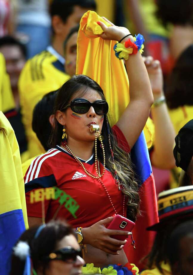 BRASILIA, BRAZIL - JUNE 19:  A Colombia fan enjoys the atmosphere during the 2014 FIFA World Cup Brazil Group C match between Colombia and Cote D'Ivoire at Estadio Nacional on June 19, 2014 in Brasilia, Brazil. Photo: Christopher Lee, Getty Images / 2014 Getty Images