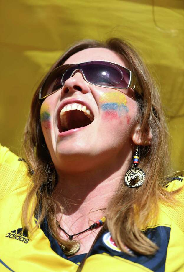 BRASILIA, BRAZIL - JUNE 19:  A Colombia fan enjoys the atmosphere prior to the 2014 FIFA World Cup Brazil Group C match between Colombia and Cote D'Ivoire at Estadio Nacional on June 19, 2014 in Brasilia, Brazil. Photo: Christopher Lee, Getty Images / 2014 Getty Images