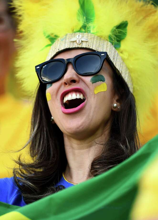 SAO PAULO, BRAZIL - JUNE 12:  A Brazil fan cheers during the Opening Ceremony of the 2014 FIFA World Cup Brazil prior to the Group A match between Brazil and Croatia at Arena de Sao Paulo on June 12, 2014 in Sao Paulo, Brazil. Photo: Christopher Lee, Getty Images / 2014 Getty Images