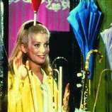 THE UMBRELLAS OF CHERBOURG:  A young love film that morphs into something else.