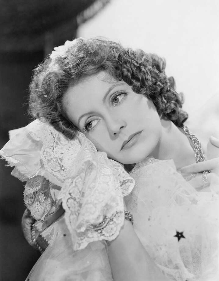CAMILLE (1936) -- a courtesan finds redemption at the eleventh hour, when she falls selflessly in love with an idealistic young man.  Garbo films were almost always about the woman's redemption through love and sacrifice.