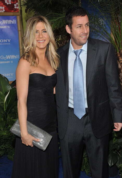 """Jennifer Aniston and Adam Sandler attend the premiere of """"Just Go With It,"""" in which a man realizes that he's in love with his co-worker, Aniston, and not some goddess on the beach. Photo: Theo Wargo, FilmMagic / 2011 FilmMagic"""