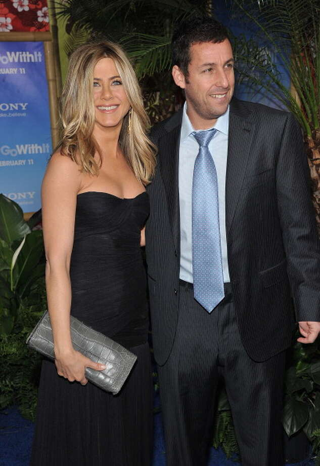 "Jennifer Aniston and Adam Sandler attend the premiere of ""Just Go With It,"" in which a man realizes that he's in love with his co-worker, Aniston, and not some goddess on the beach. Photo: Theo Wargo, FilmMagic / 2011 FilmMagic"