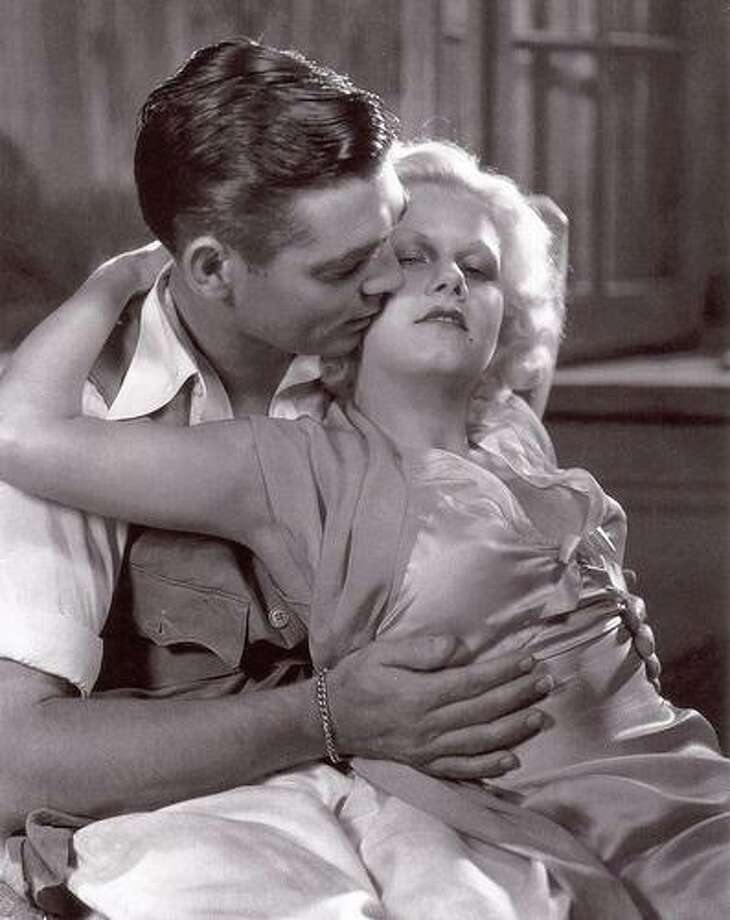 "Clark Gable and Jean Harlow in ""Red Dust.""  He thinks he's in love with the refined Mary Astor, but he's really in love with the woman who is just like he is."