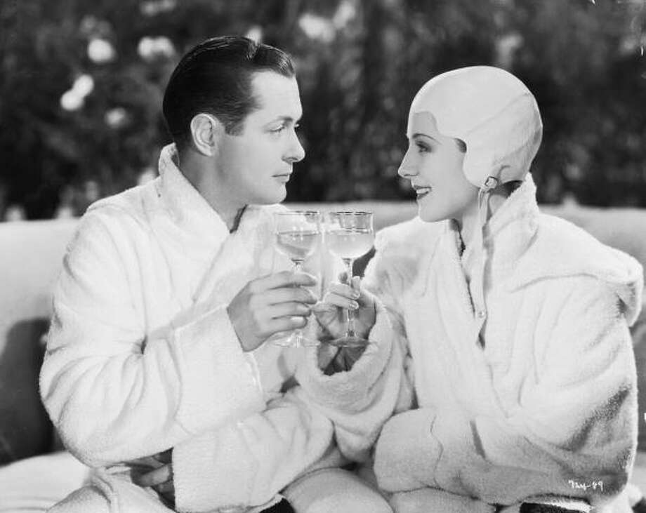 Norma Shearer flirts with Robert Montgomery, but it goes no further -- until her husband accuses her of adultery.  Then she figures she might as well go ahead and do it, in RIPTIDE (1934)  -- made right before the Production Code came in. Photo: Milton Brown, Getty Images