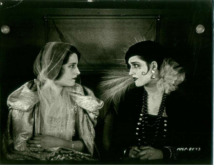 """Norma Shearer plays rich girl Florence (left) and poor girl Molly (right) in """"Lady of the Night.""""  A great movie about the social context's effect on love, it's about a man who chooses the rich girl and doesn't  notice the poor girl -- that is, he doesn't even notice that they're identical.  All he sees is class and money. Photo: MGM 1925"""