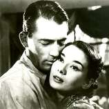 ROMAN HOLIDAY  lots of elements, but the social context dominates.  She's royalty, and he's not.