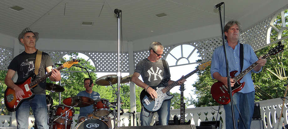 The Distractions perform Sunday evening at the Sherman Green gazebo. Photo: Mike Lauterborn / Fairfield Citizen