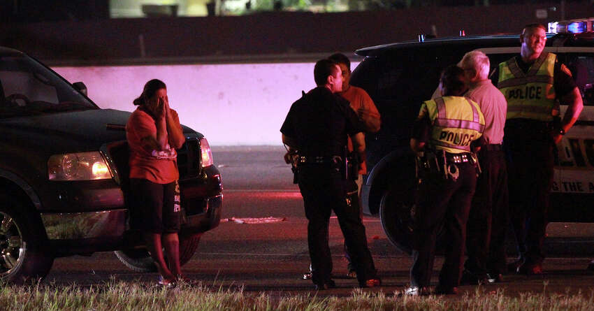 San Antonio police investigate the scene of a fatal car crash that took place about 3:30 a.m. Monday, June 23, 2014, on northbound U.S. 281 near Nakoma. According to local television reports, police said the driver of the vehicle slammed into a concrete pillar and the car caught fire. Northbound 281 was reduced to one lane of traffic while the accident was being cleared.