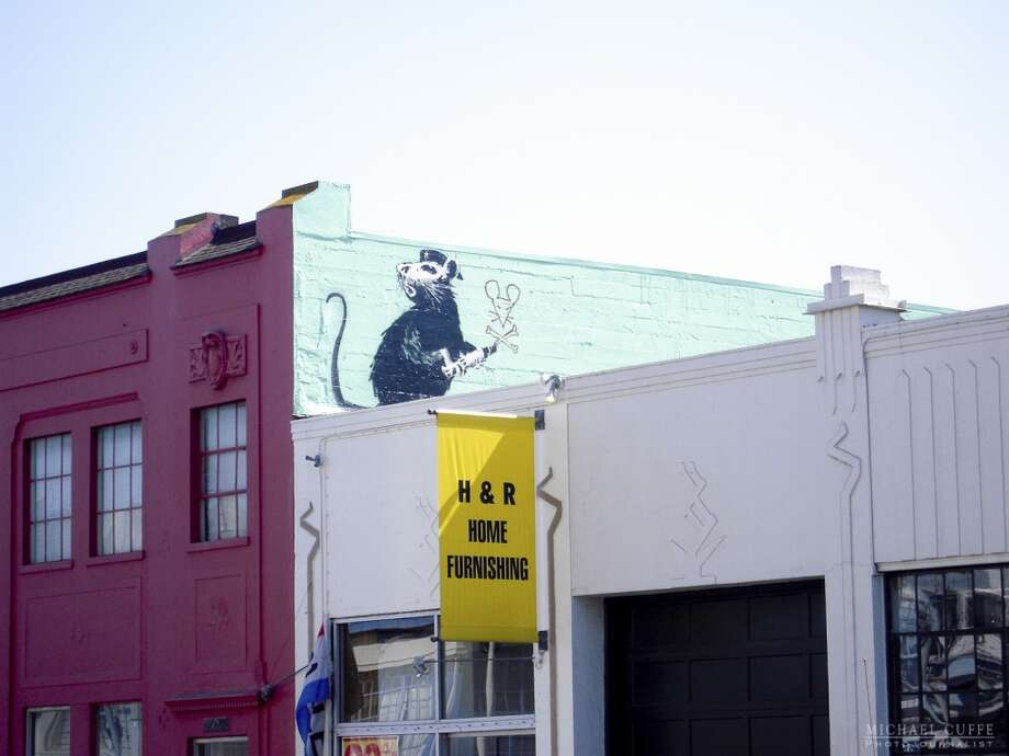 This Banksy piece depicts another rat in a cap. It was drawn at 1309 Howard St. in San Francisco during the artist's 2010 visit. Photo: Photograph By Michael Cuffe