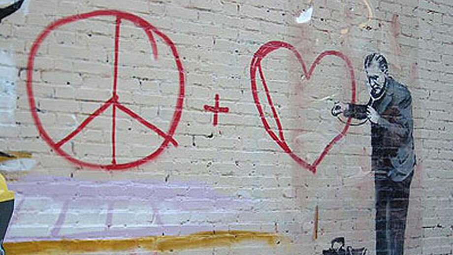 This Banksy piece depicting a doctor listening to a heart symbol was drawn at 720 Grant Ave. in San Francisco's Chinatown. This photo was provided by  KQED Arts. Photo: Sandra Silvoy, Courtesy Of KQED Arts