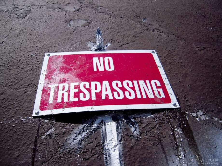 "A closer look at the ""No Trespassing"" sign. Photo: Photograph By Michael Cuffe"