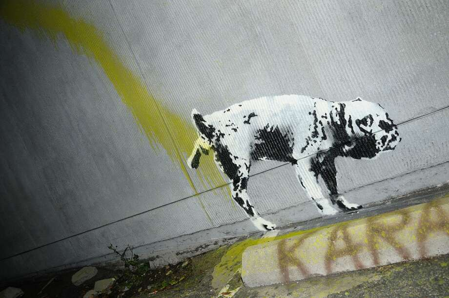 Banksy visited Los Angeles in 2011. This piece shows a dog urinating on a wall. Photo: Jason LaVeris, FilmMagic
