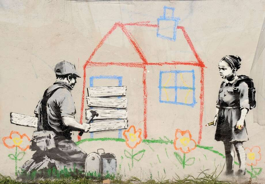 "This Los Angeles Banksy is called ""Crayon Foreclosure."" Photo: Jason LaVeris, FilmMagic"