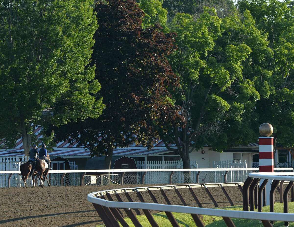 A horse is lead out for its morning exercise at Saratoga Race Course on the opening day of the main track for training JMonday morning, June 23, 2014, in Saratoga Springs, N.Y. The 151st race meeting at the historic track will begin on July 18th and run through Labor Day. (Skip Dickstein/Times Union)