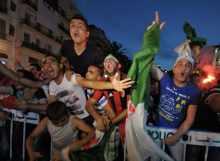 Much of the world is rejoicing in the World Cup, including these Algerian soccer fans. One  reader, however, does not count himself among the joyous. Photo: Sidali Djarboub, Associated Press / AP