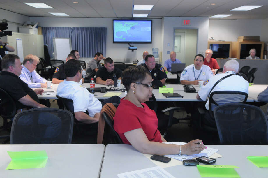 Gayle McRae of the health department joins fellow city officials in the Emergency Operation Center on the 6th floor of the Government Center to practice emergency preparedness plans in Stamford, Conn., June 23, 2014. The exercise tested response and coordination in the event of a category 1 hurricane. The drills were practiced statewide and were coordinated by the Department of Emergency Services and Public Protection's Division of Emergency Management and Homeland Security. Photo: Keelin Daly / Stamford Advocate Freelance