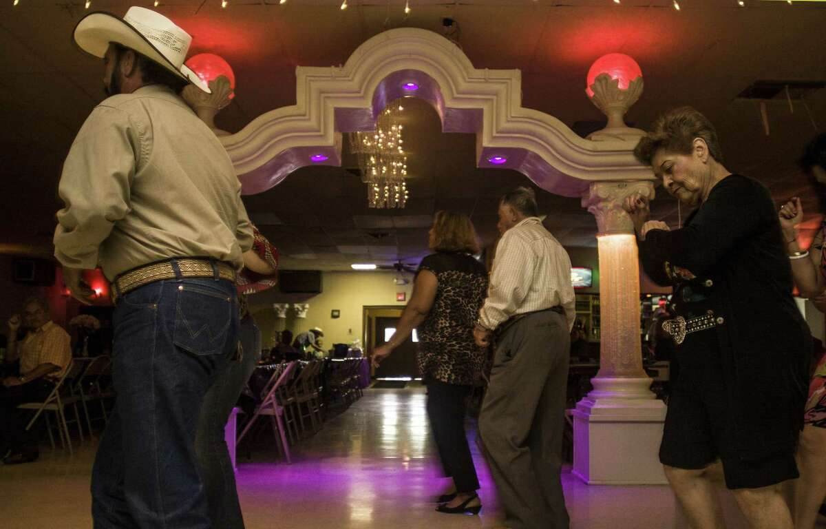 The gotta-get-up-and-dance rhythms of cumbia bring people out of their chairs on a recent afternoon at the Royal Palace Ballroom at 3506 S.W. Military Drive. Dances are held from 2 to 5 p.m. Sunday through Thursday; admission costs $2.