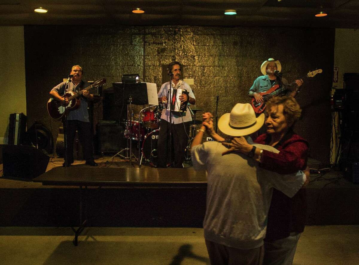 Dancers take to the floor of the Royal Palace Ballroom as Ruben Tellez and his band play classic conjunto music.