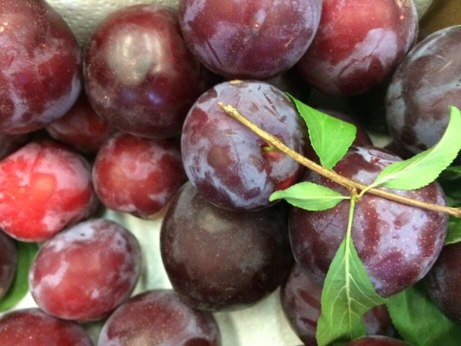 Bounty of plums shared with office-mates Photo: Leah Garchik