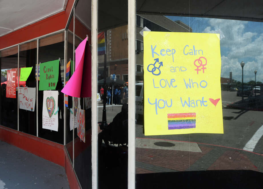 Signs are taped to the windows of the Orleans Pavilion during the Beaumont Pride event Saturday. Beaumont's first ever gay pride event was held on Saturday. The day began with a walk from the intersection of Martin Luther King Parkway and Broadway into the 500 and 600 block of Orleans Street in downtown Beaumont.