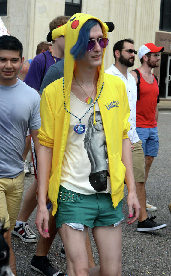 Supporters flaunt their fashions on Orleans Street during Beaumont's first Pride Parade on Saturday. 