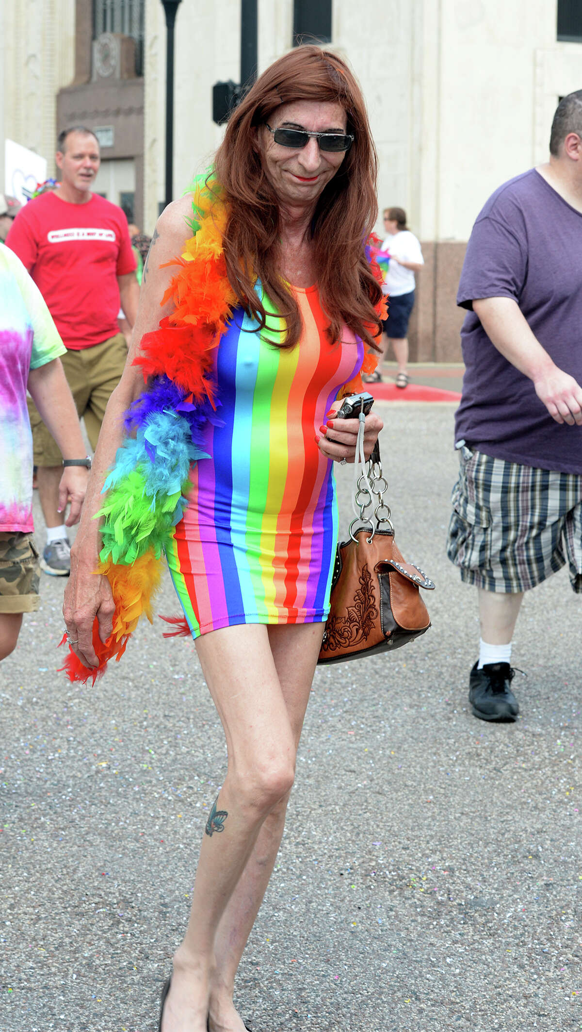 Supporters flaunt their fashions on Orleans Street during Beaumont's first Pride Parade on Saturday. Photo taken Saturday, June 21, 2014 Guiseppe Barranco/@spotnewsshooter