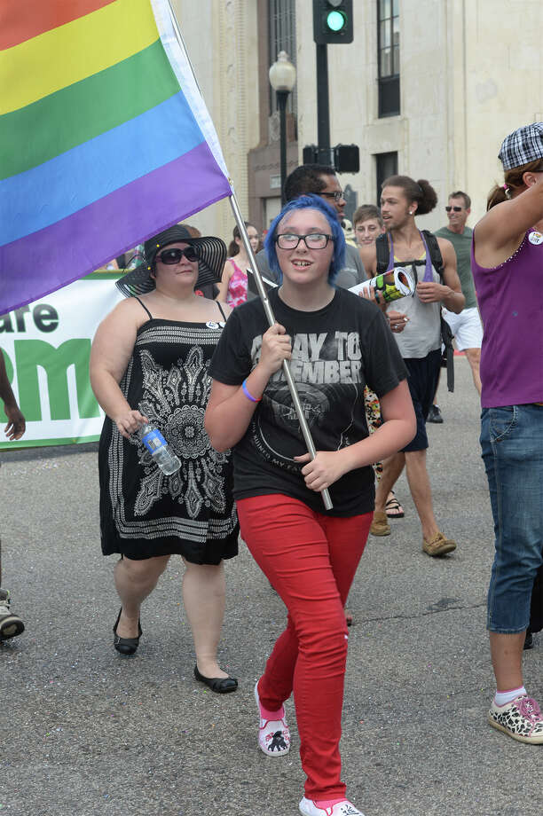 Supporters show their pride on Orleans Street during Beaumont's first Pride Parade on Saturday.  Photo taken Saturday, June 21, 2014 Guiseppe Barranco/@spotnewsshooter Photo: Guiseppe Barranco, Photo Editor