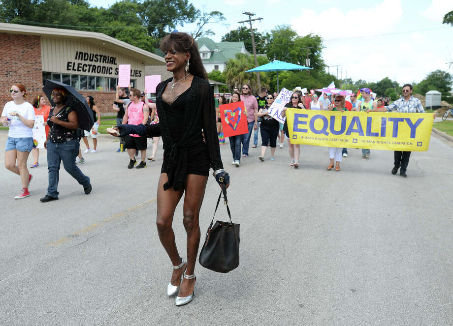 Rhonda and other marchers participate in Saturday's Pride Walk down Broadway Street. Beaumont's first ever gay pride event was held on Saturday. The day began with a walk from the intersection of Martin Luther King Parkway and Broadway into the 500 and 600 block of Orleans Street in downtown Beaumont.