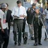 newsomhomeless006_ward.jpg The mayor made a tour of hotels catering to the homeless in the Tenderloin area, often stopping and talking with homeless along the way...he filled out a survey as he walked for this homeless woman, Elizabeth Jasoni-Gardipe...part of the massive outreach program by city workers.During 2004, Mayor Gavin Newsom of San Francisco went into the streets to talk with the homeless, even counseling some during a walk in the Tenderloin area.  Ran on: 12-05-2004Mayor Gavin Newsom helps fill out a survey for Elizabeth Jasoni-Gardipe (on crutches), who is homeless,  as he takes a walking tour of hotels catering to the homeless in the Tenderloin. The first-term mayor and his staff are upbeat about ending San Francisco's reputation as the city with the nation's worst homelessness problem.Ran on: 12-05-2004Mayor Gavin Newsom helps fill out a survey for Elizabeth Jasoni-Gardipe (on crutches), who is homeless,  as he takes a walking tour of hotels catering to the homeless in the Tenderloin. The first-term mayor and his staff are upbeat about ending San Francisco's reputation as the city with the nation's worst homelessness problem.