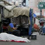 A homeless encampment near a freeway off ramp that people only use in the evenings. In San Francisco, Calif. it has been ten years since the Care Not Cash program was initiated and to end chronic homelessness but the results have not been as hoped.