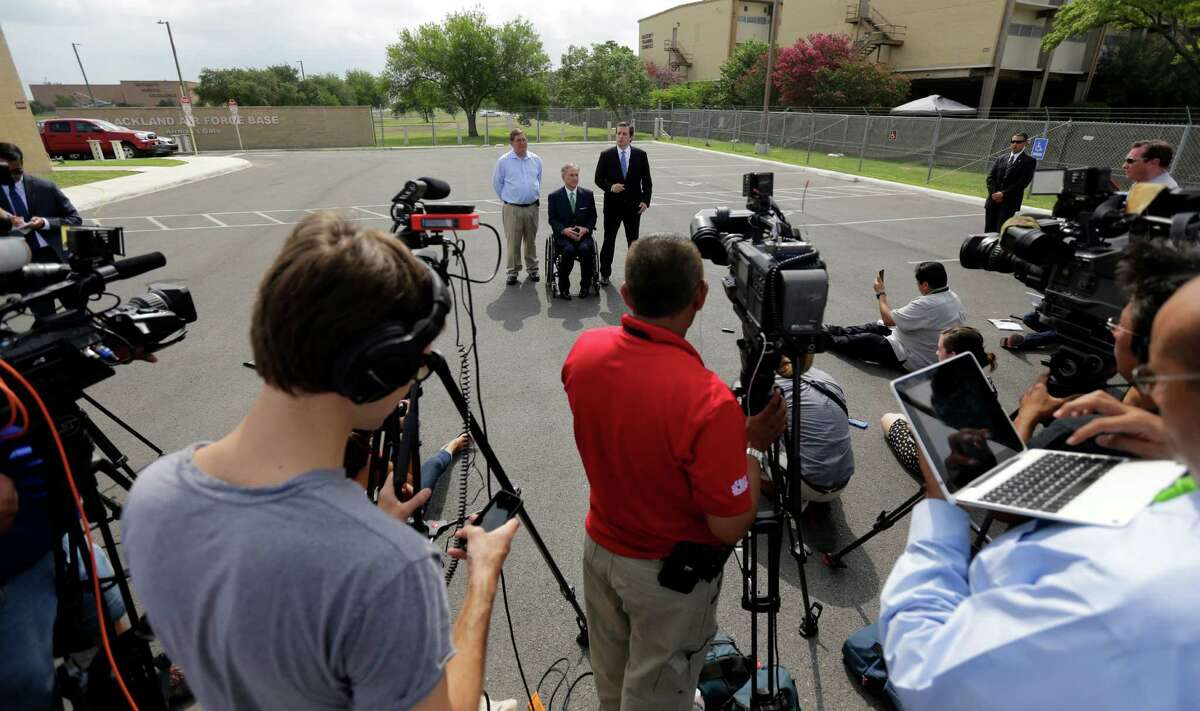 U.S. Sen. Ted Cruz, right, with U.S. Rep Michael Bachmann, left, and Attorney Gen. and Republican gubernatorial candidate Greg Abbott, center, talk to the media outside a temporary shelter for unaccompanied minors who have entered the country illegally at Lackland Air Force Base , Monday, June 23, 2014, in San Antonio.Cruz and Abbott are ramping up criticism of President Barack Obama for more than 52,000 unaccompanied minors who have poured across the southwestern border of the U.S. in recent months. (AP Photo/Eric Gay)