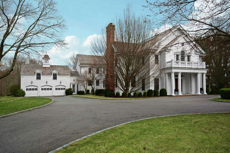 The Georgian Colonial Revival at 487 West Road in New Canaan offers more than 10,000 square feet of living space. It is on the market for $4,995,000. Photo: Contributed Photo, Contributed / New Canaan News Contributed
