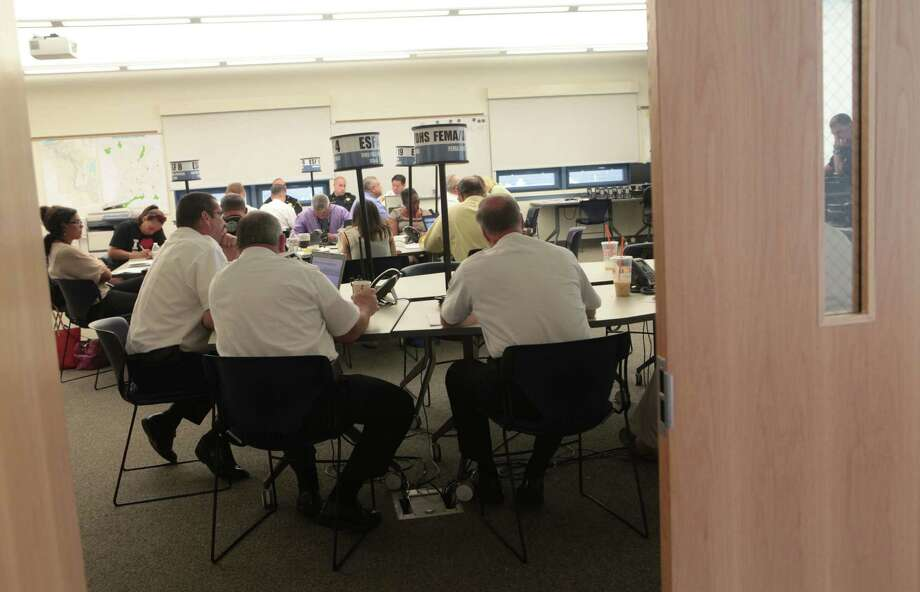 Scott Appleby, Director of Emergency Management for the City of Bridgeport, far right, representatives from the State of Connecticut; and other emergency management officials participate in an emergency preparedness drill at the Office of Emergency Management & Homeland Security in Bridgeport, Conn. on Monday, June 23, 2014. Photo: BK Angeletti, B.K. Angeletti / Connecticut Post freelance B.K. Angeletti