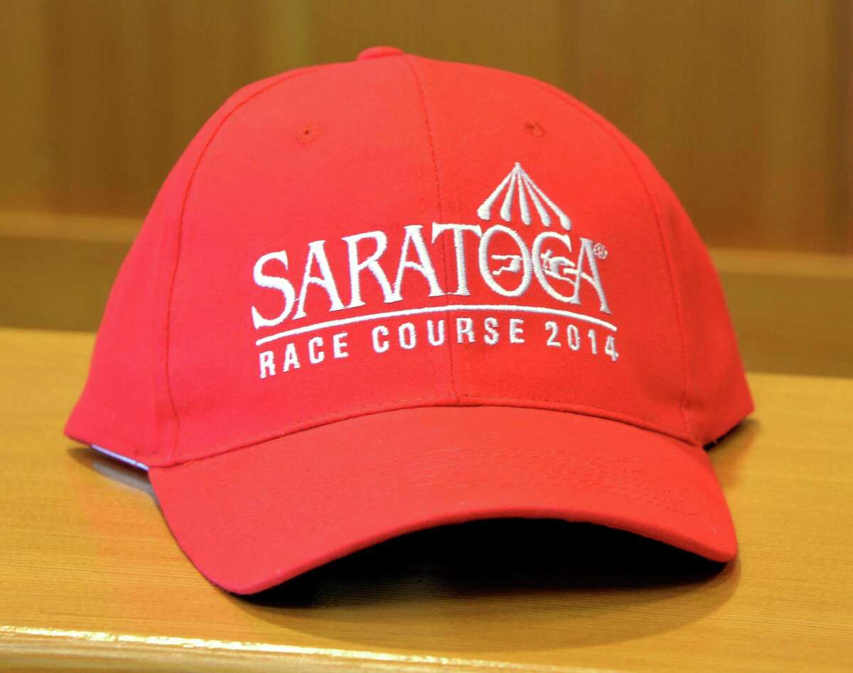 A Saratoga baseball cap will be one of the four giveaway items for this year's Saratoga Race Course meeting. It was displayed during a press briefing about the upcoming race season Monday afternoon, June 23, 2014, at Saratoga, N.Y. The hat will be given away July 20. (Skip Dickstein / Times Union)