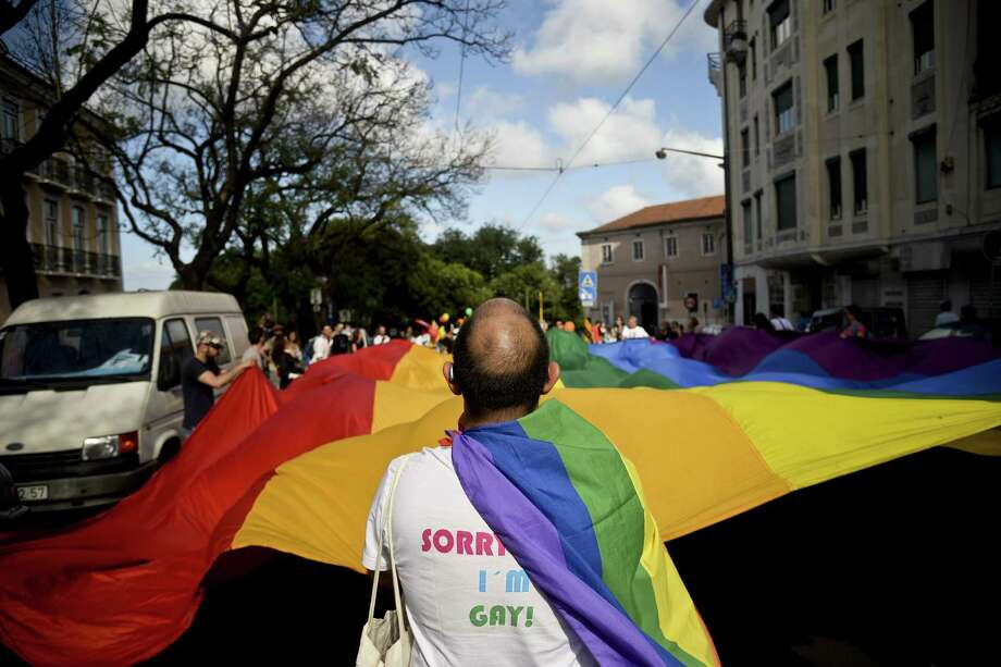 Lisbon, PortugalA man holds a giant rainbow flag during the Gay Pride Parade in Lisbon, Portugal on Saturday, June 21, 2014.  Photo: PATRICIA DE MELO MOREIRA, AFP/Getty Images / AFP ImageForum
