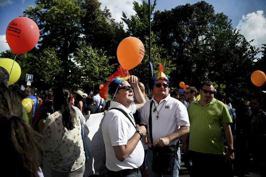 Lisbon, PortugalMen wearing rainbow wigs take part of the Gay Pride Parade in Lisbon, Portugal on Saturday, June 21, 2014.  Photo: PATRICIA DE MELO MOREIRA, AFP/Getty Images / AFP ImageForum