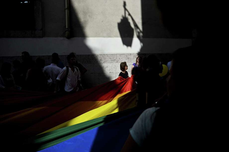 Lisbon, PortugalA woman holds a giant rainbow flag during the Gay Pride Parade in Lisbon, Portugal on Saturday,  June 21, 2014.  Photo: PATRICIA DE MELO MOREIRA, AFP/Getty Images / AFP ImageForum