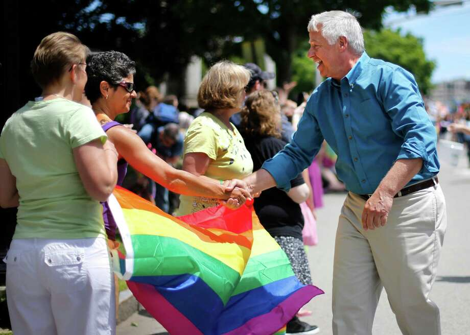 Portland, MaineU.S. Rep. Mike Michaud, a Democratic candidate for governor, greets spectators at the Portland Pride Parade, Saturday, June 21, 2014, in Portland, Maine. Gay rights activists around the country are eyeing the Maine's governor's race as a chance to make history. Michaud would become the first openly gay candidate to become governor if he unseats vulnerable Republican Gov. Paul LePage in November. (AP Photo/Robert F. Bukaty) Photo: Robert F. Bukaty, Associated Press / AP