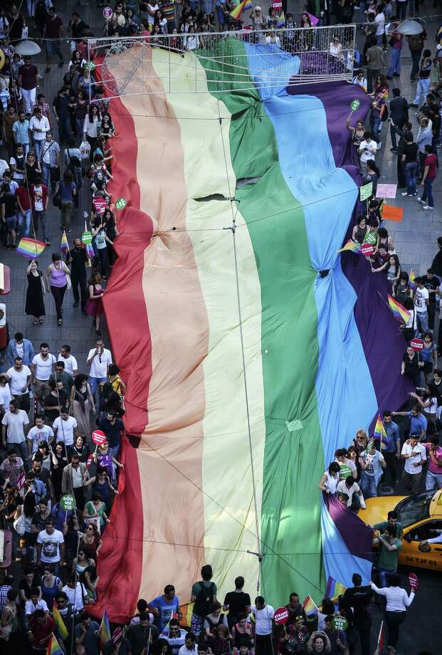 Istanbul, TurkeyPeople hold a giant rainbow flag during a gay parade on Istiklal Street, the main shopping corridor on Sunday, June 22, 2014 in Istanbul, Turkey during the Trans Pride Parade as part of the Trans Pride Week 2014, which is organized by Istanbul's 'Lesbians, Gays, Bisexuals, Transvestites and Transsexuals' (LGBTT) solidarity organization.   Photo: BULENT KILIC, AFP/Getty Images / AFP