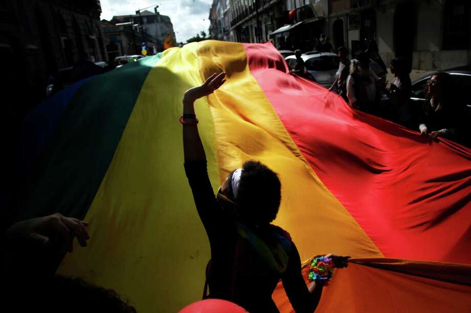 Lisbon, PortugalRevelers hold a giant rainbow flag during the Gay Pride parade celebration in Lisbon, Portugal on Saturday, June 21, 2014.  Photo: Francisco Seco, Associated Press / AP