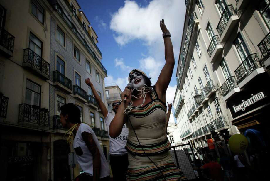 Lisbon, PortugalA reveller performs during the Gay Pride parade celebration in Lisbon, Portugal on Saturday, June 21, 2014.  Photo: Francisco Seco, Associated Press / AP