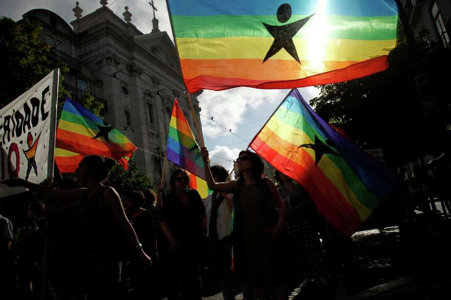 Lisbon, PortugalMembers of the Portuguese Left Block wave rainbow flags as they take part in the Gay Pride parade celebration in Lisbon, Portugal on Saturday, June 21, 2014.  Photo: Francisco Seco, Associated Press / AP